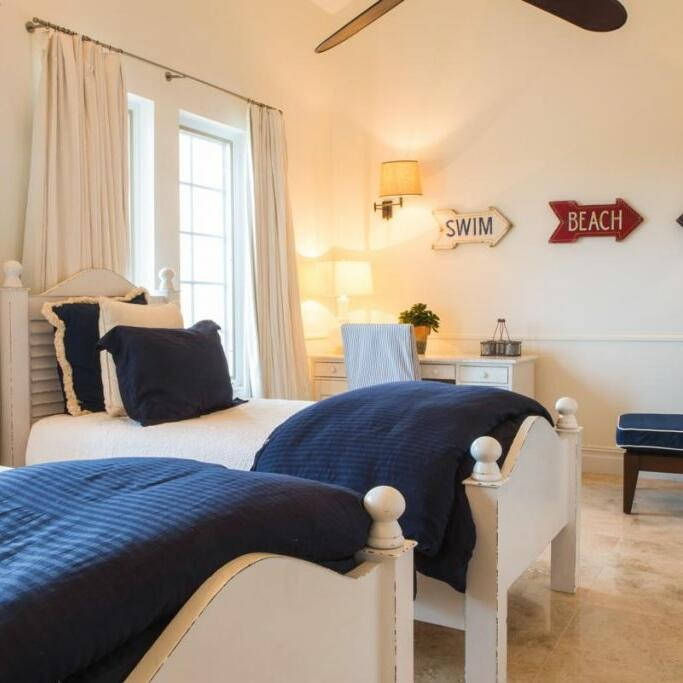 Bedroom at multi-story Residences in The Somerset On Grace Bay