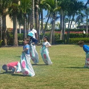 Kids engaging in Sack race at The Somerset On Grace Bay