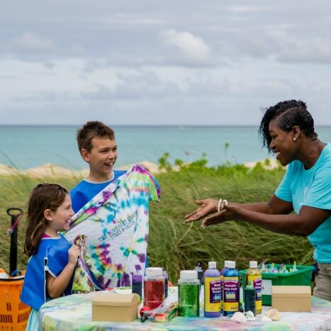 Photo of Sharon Scott with children at The Somerset Grace Bay