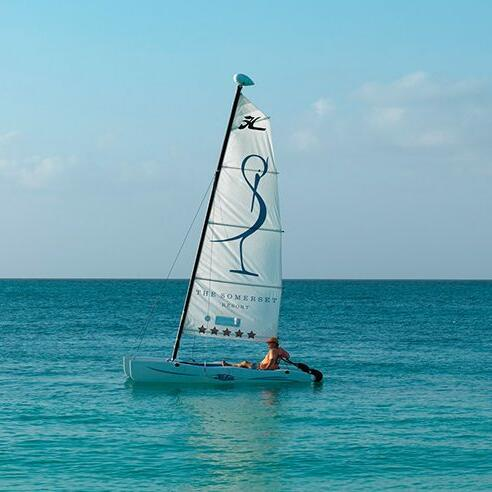 Man sailing on a boat of The Somerset On Grace Bay at the beach