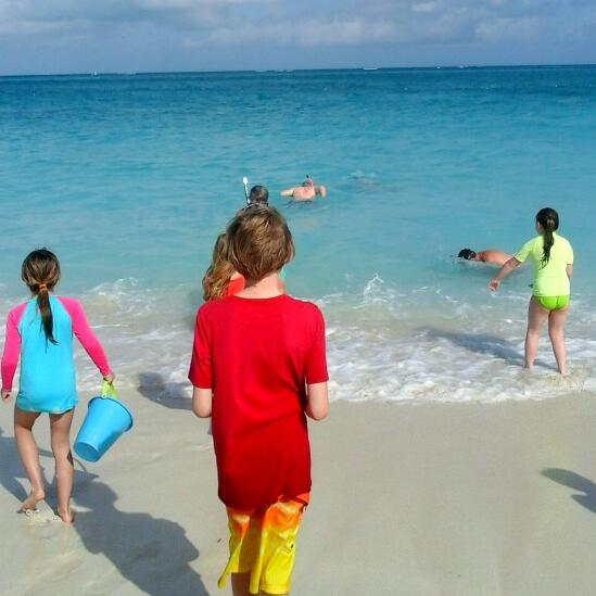 Kids playing on the beach near The Somerset On Grace Bay