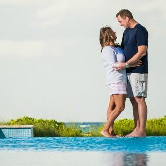 Couple by the pool at Somerset On Grace Bay