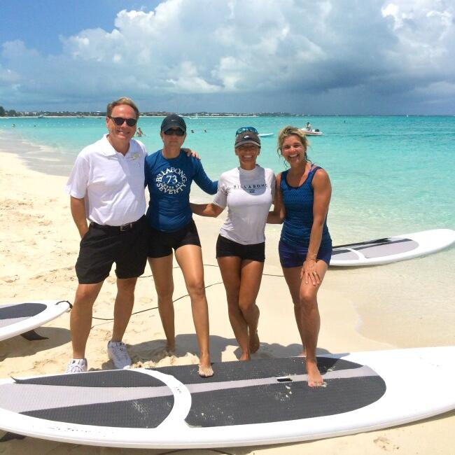 People with paddle boarding near The Somerset On Grace Bay