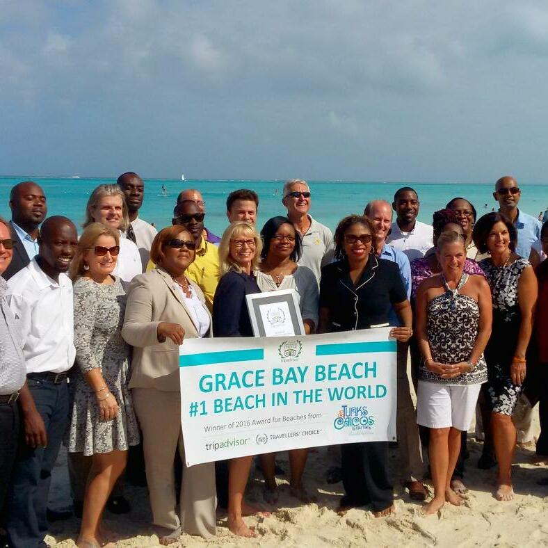 Somerset crew with World's Best Beach award at the beach