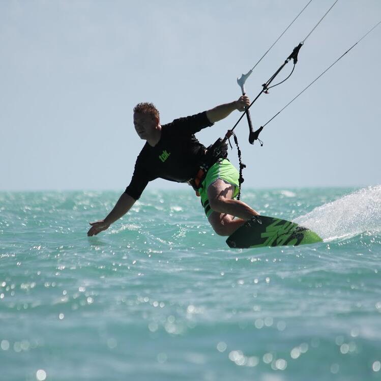 Man Kite boarding at the beach near Somerset On Grace Bay