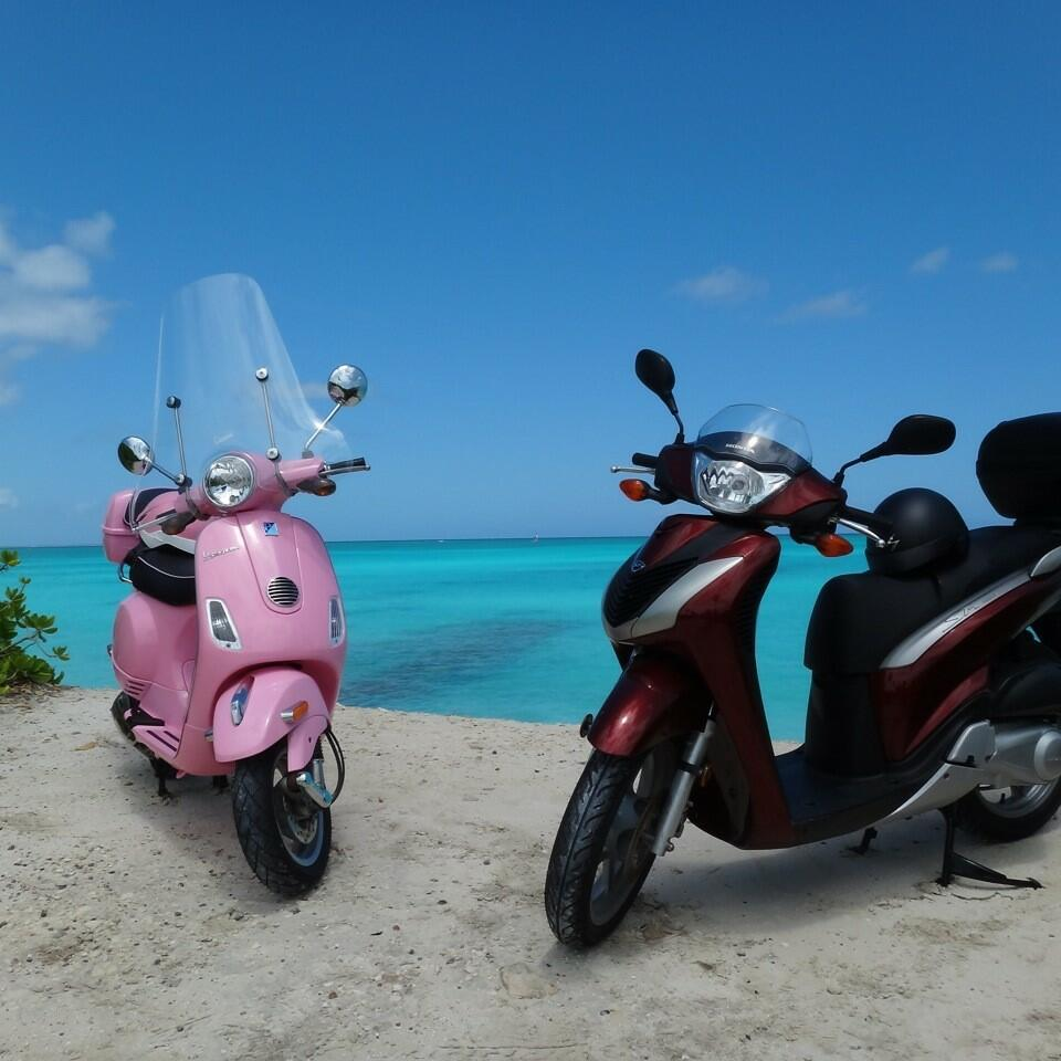 Two Scooty packed by the bay near The Somerset On Grace Bay