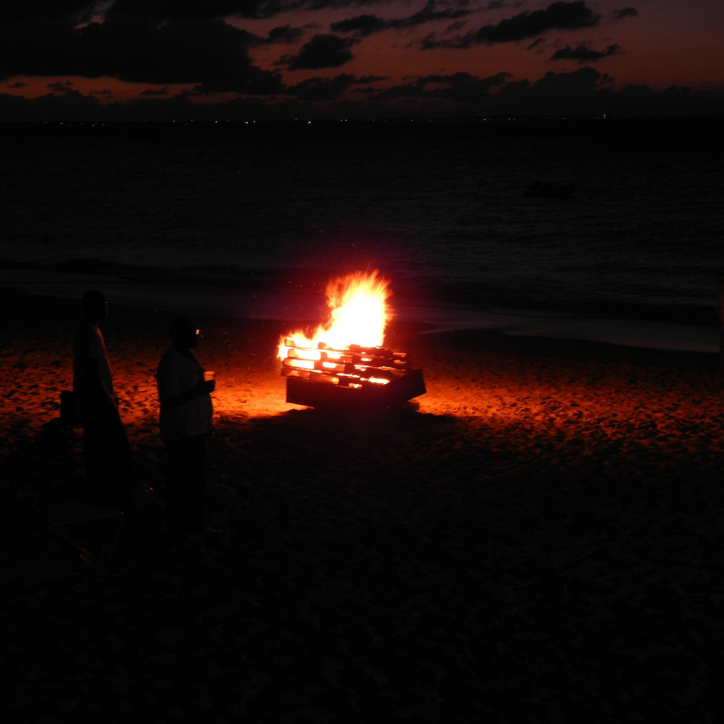 Bonfire by the beach at The Somerset On Grace Bay