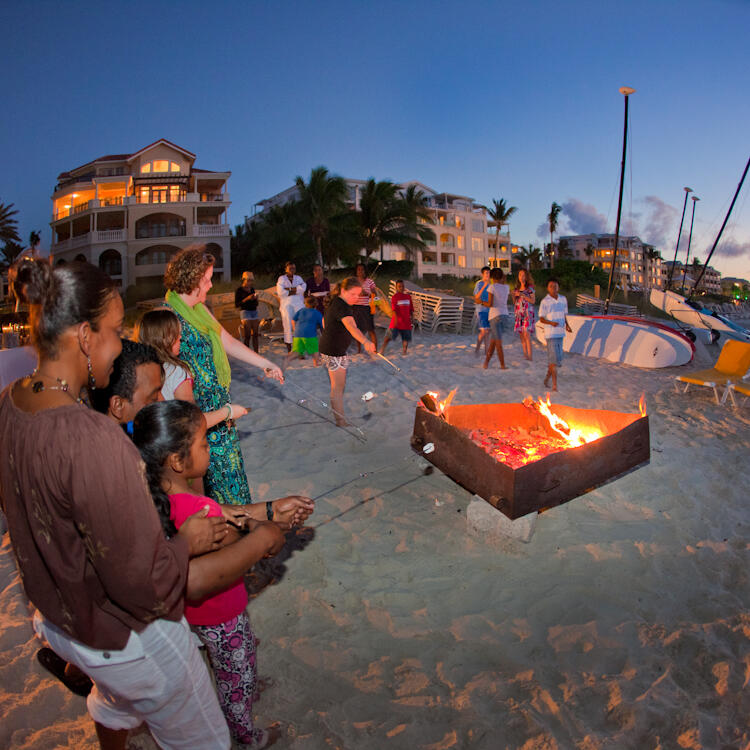 People by the Bonfire by the beach at The Somerset On Grace Bay