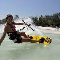 Lady doing Kite boarding at the beach near Somerset Grace Bay