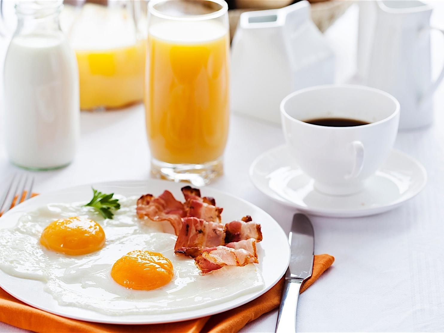 eggs, bacon, orange juice and coffee