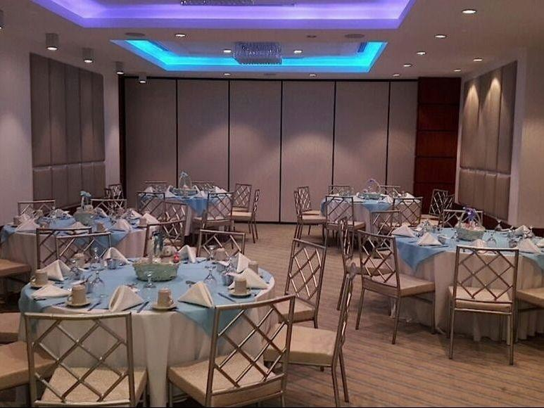 banquet room with round tables and chairs