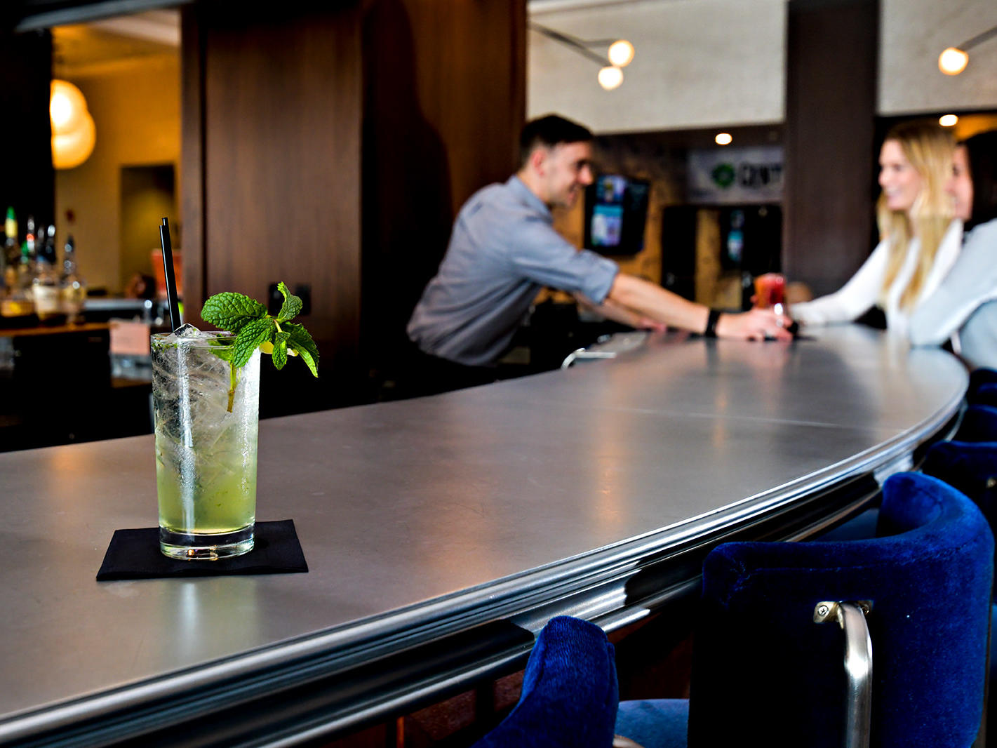 a mojito sitting at the bar in the lobby of the Grove Hotel