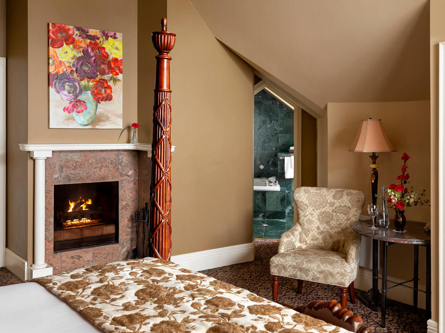 Chair and table by fireplace.