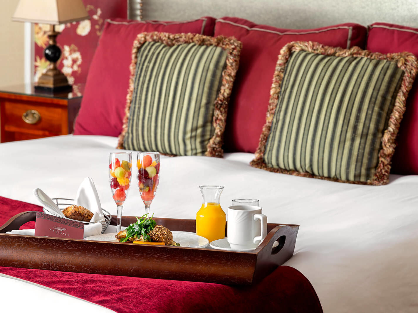 Breakfast tray on bed.