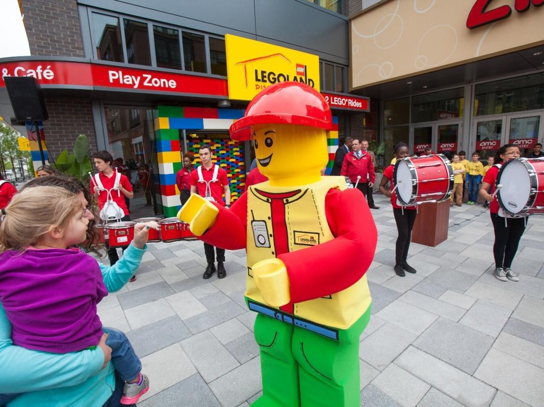 Child meeting Lego character outside of LegoLand