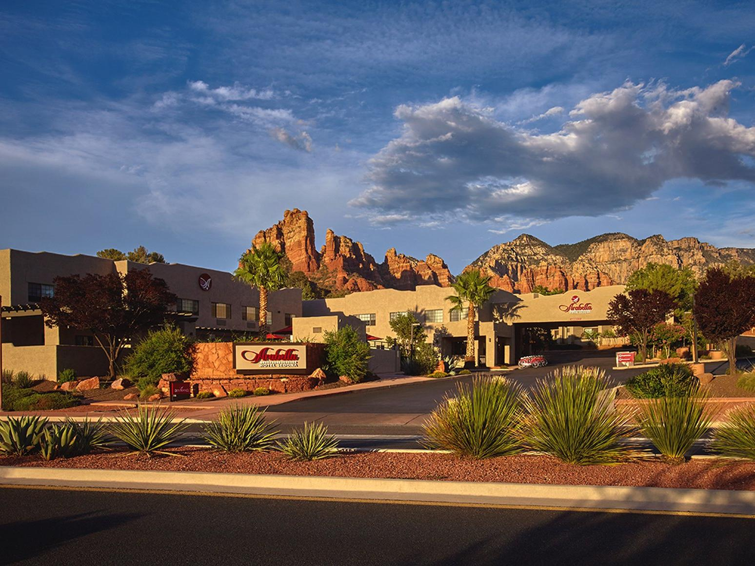 Arabella Hotel Sedona exterior with Red Rocks in background.