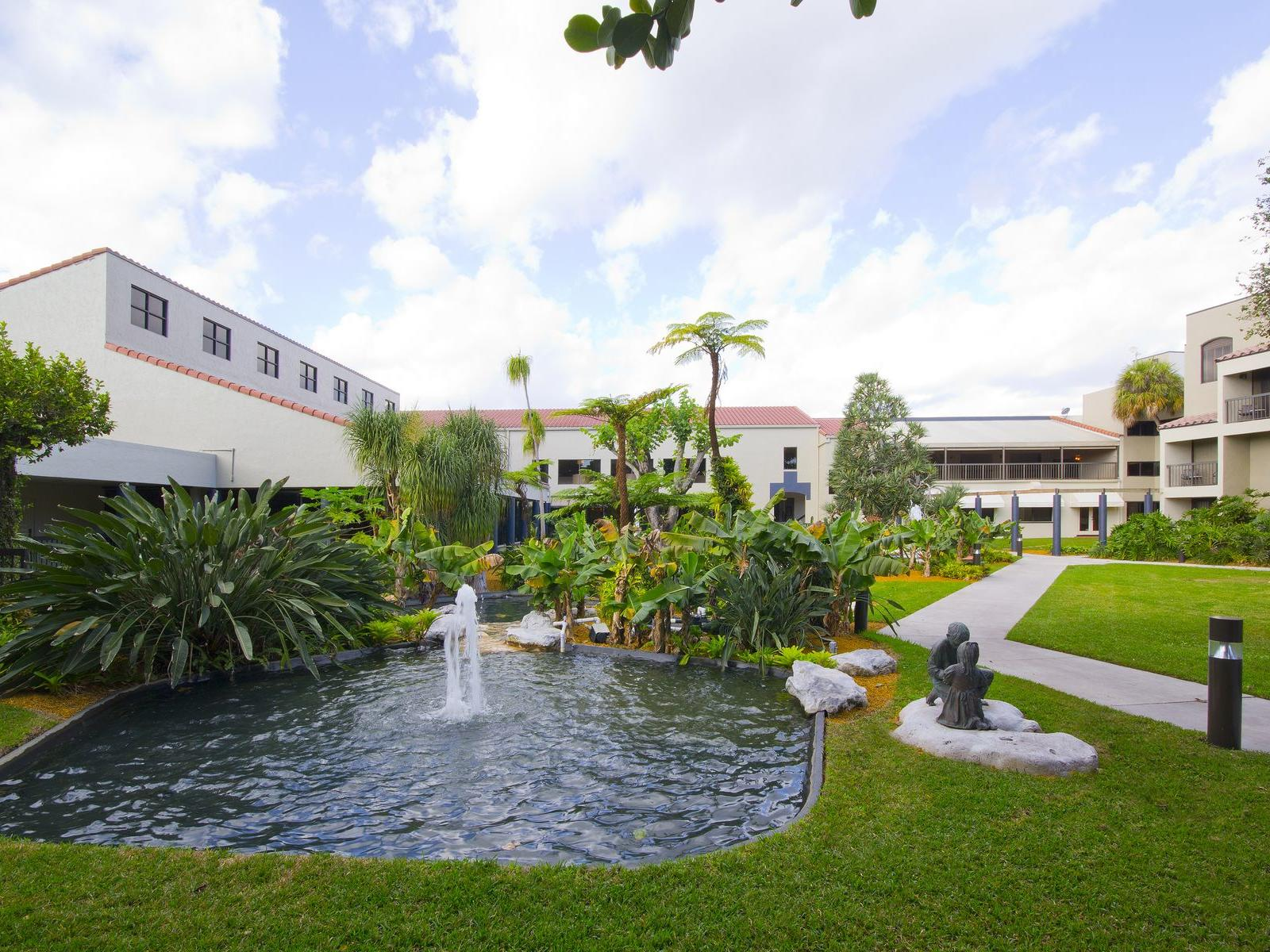 garden courtyard with lagoon