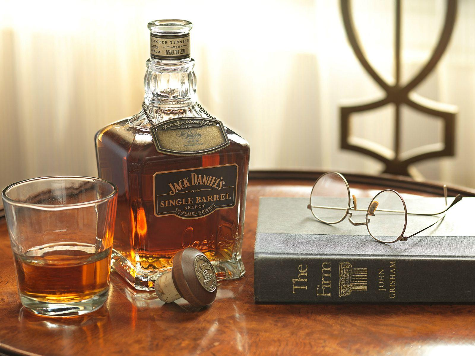 Bottle and poured glass of Jack Daniels