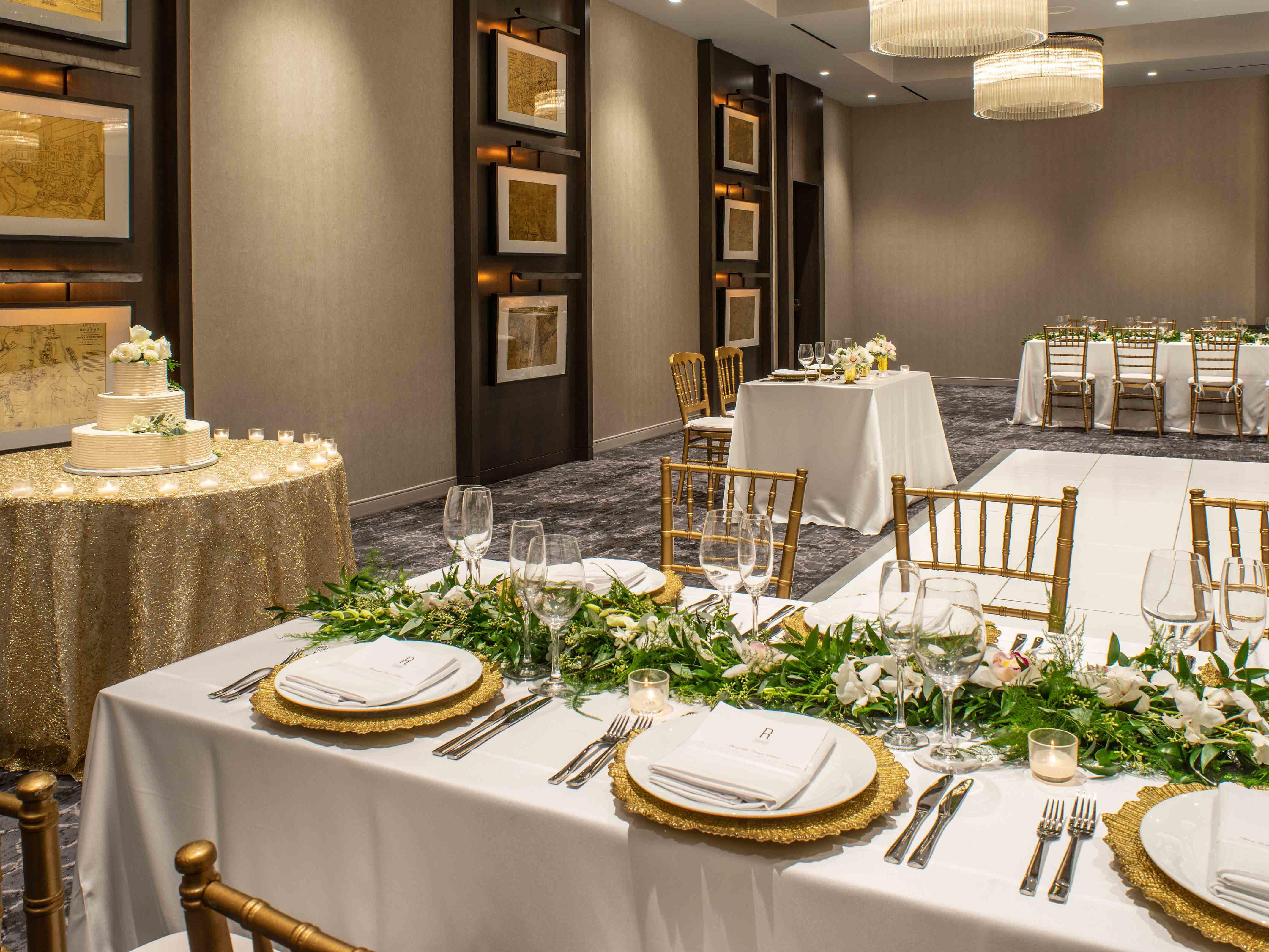 Event space set for wedding with cake on table