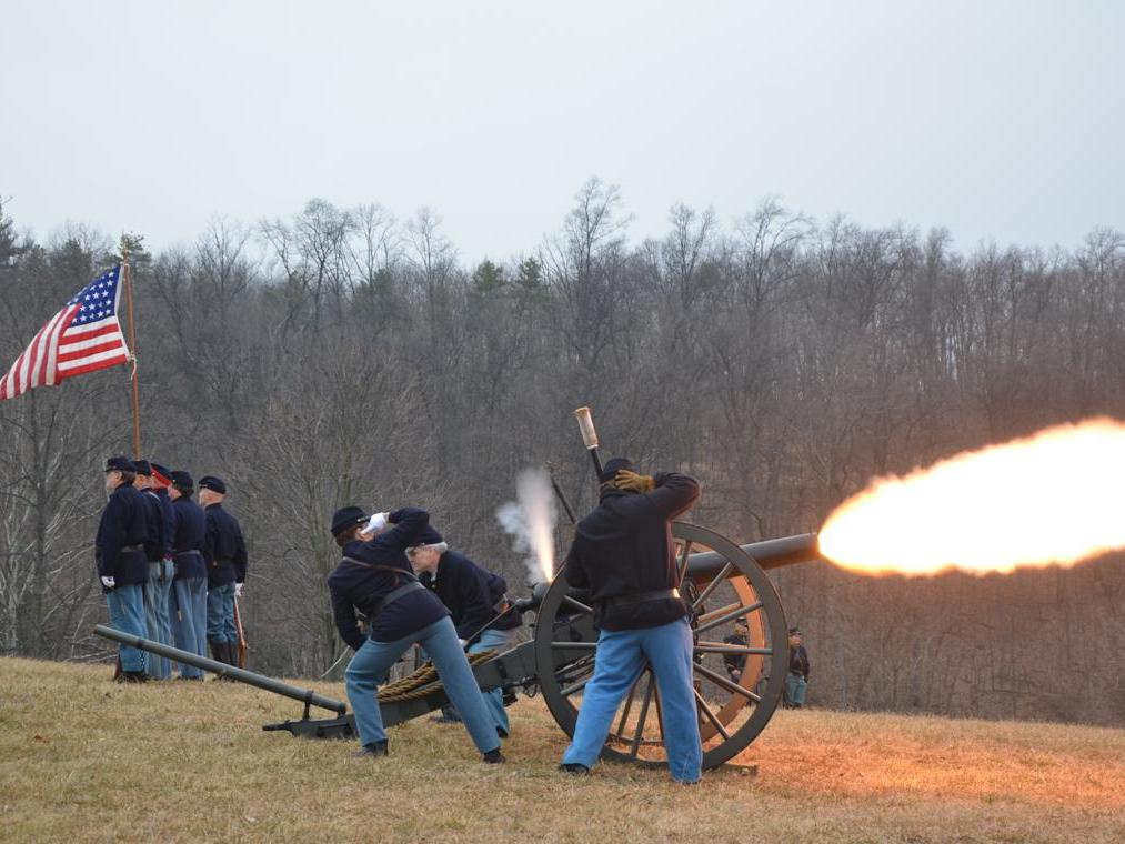 people firing a cannon