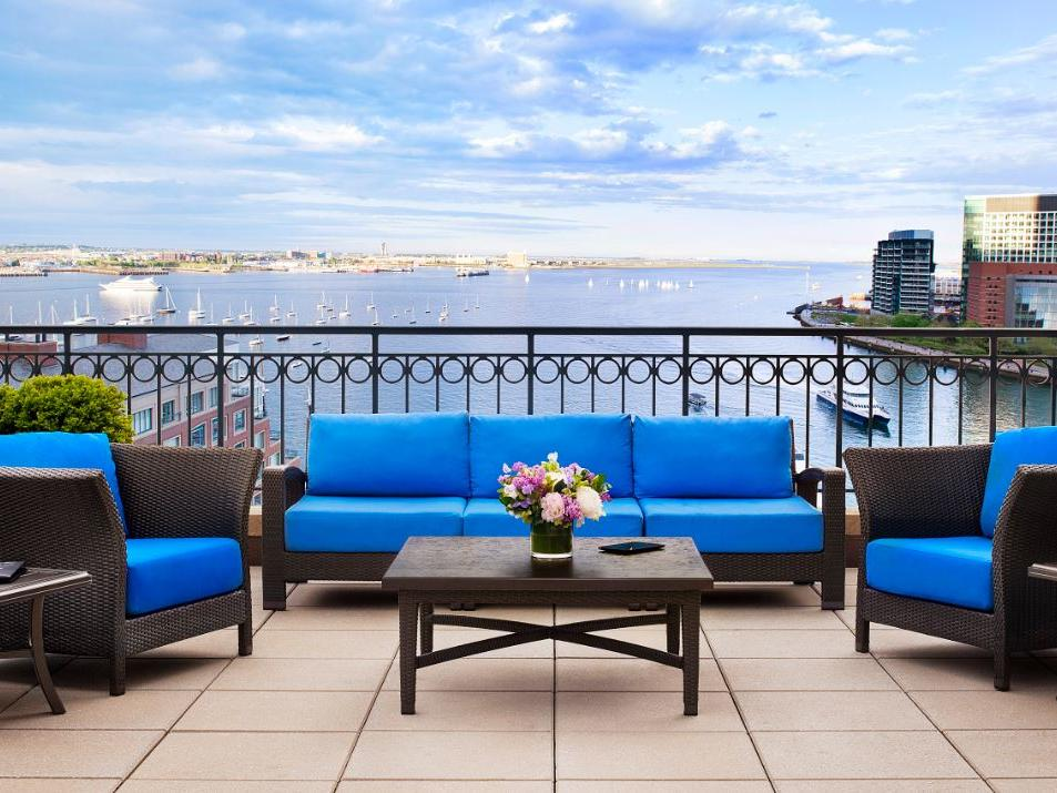 Outdoor furniture set on terrace with harbor views