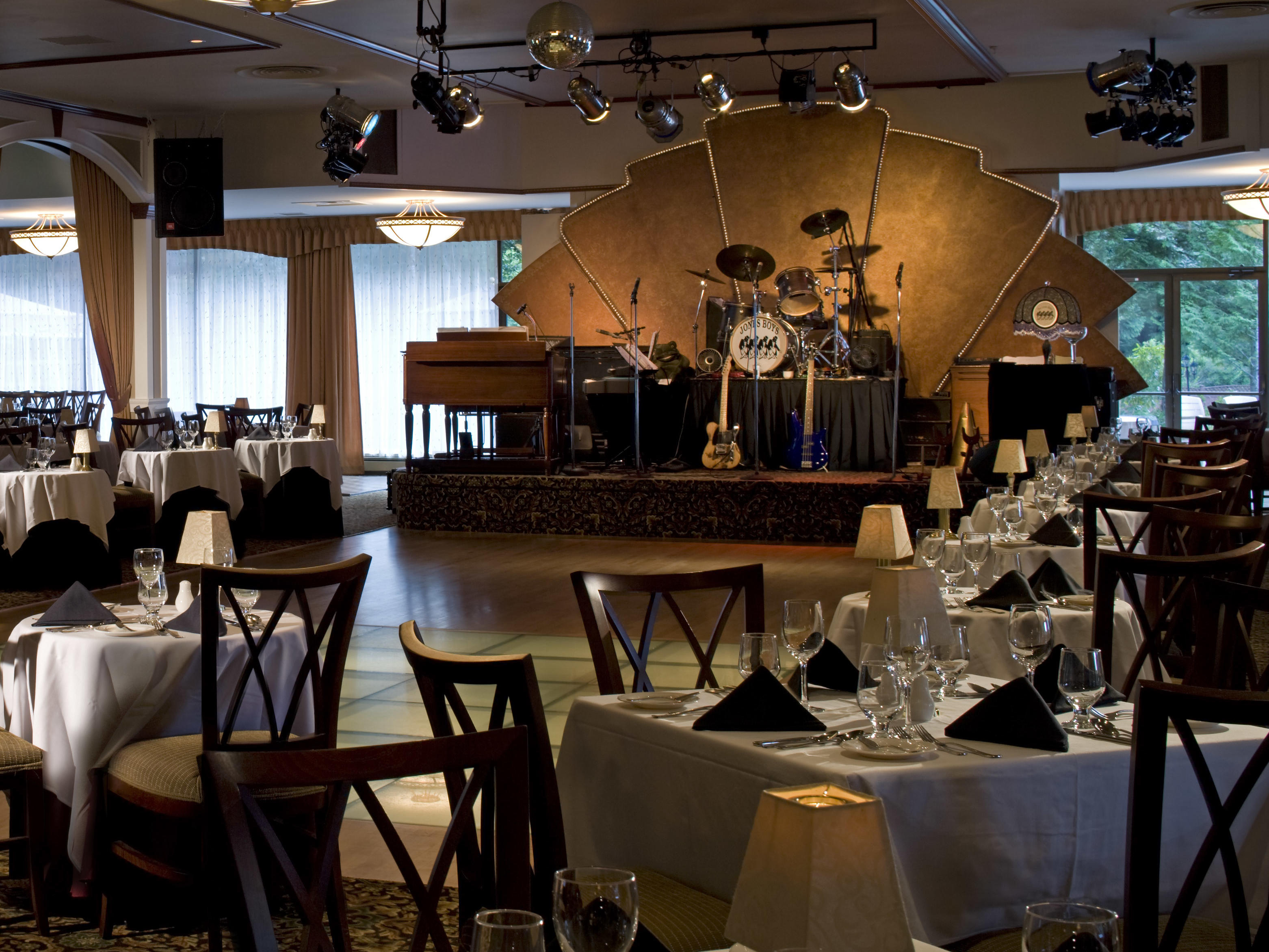 Restaurant seating and small stage.
