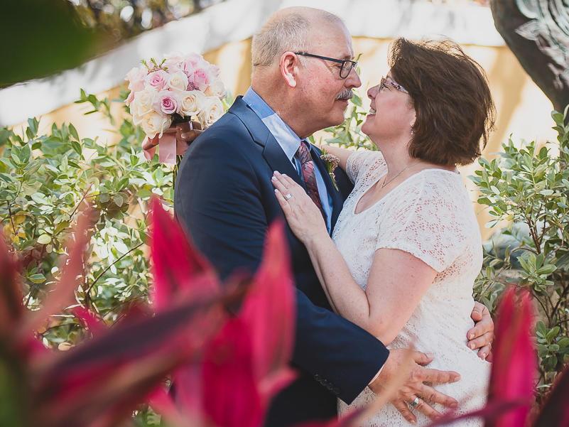 older wedding couple in garden