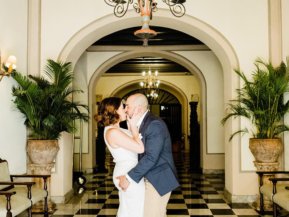 couple kissing in el convento lobby