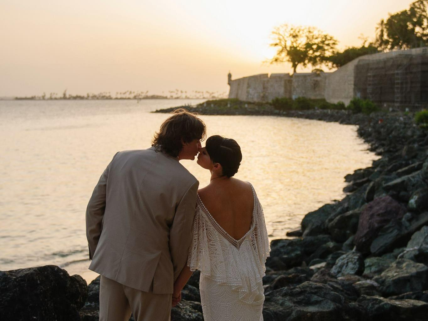 wedding couple watching sunset