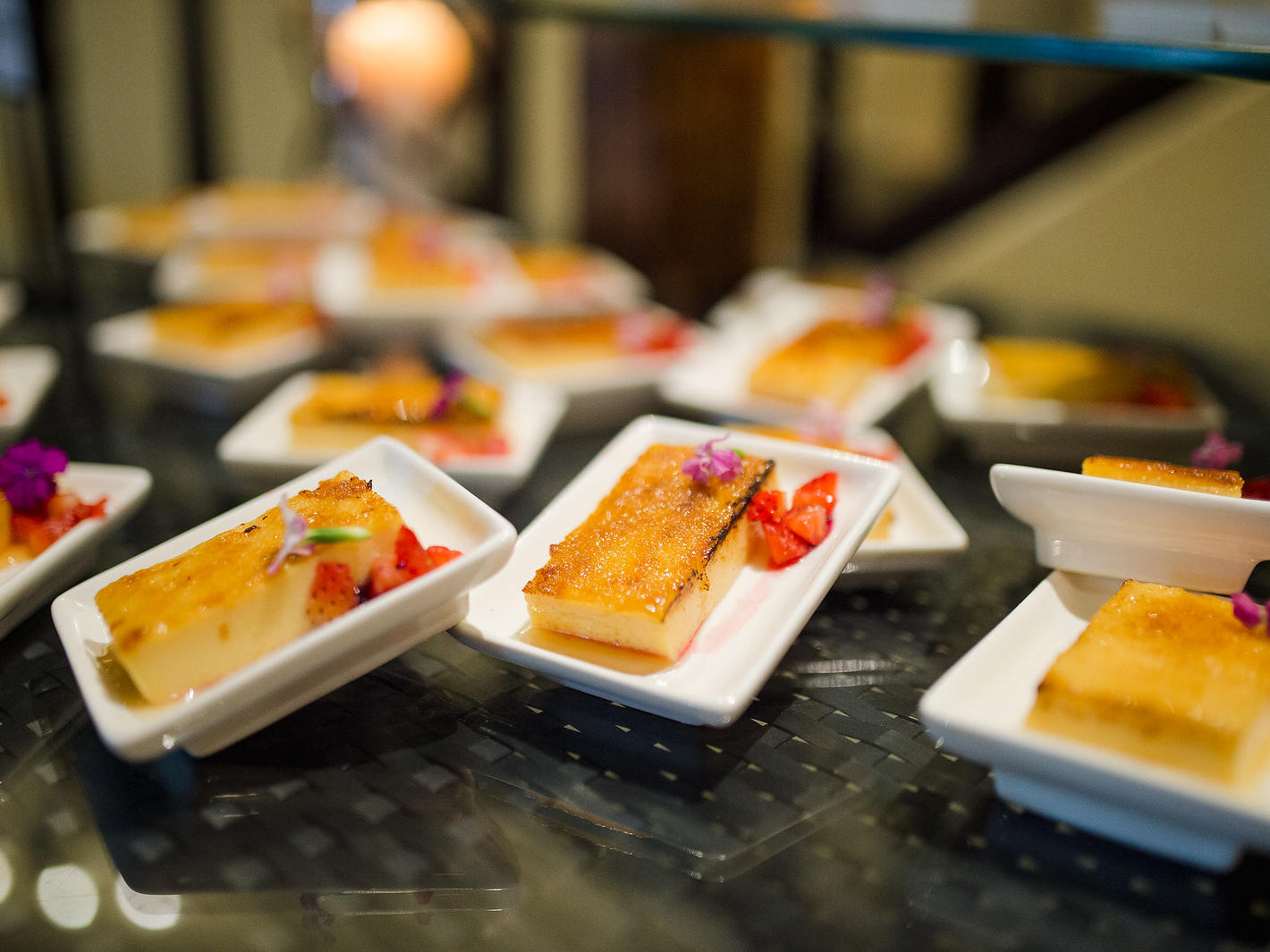 desserts station with flan plates