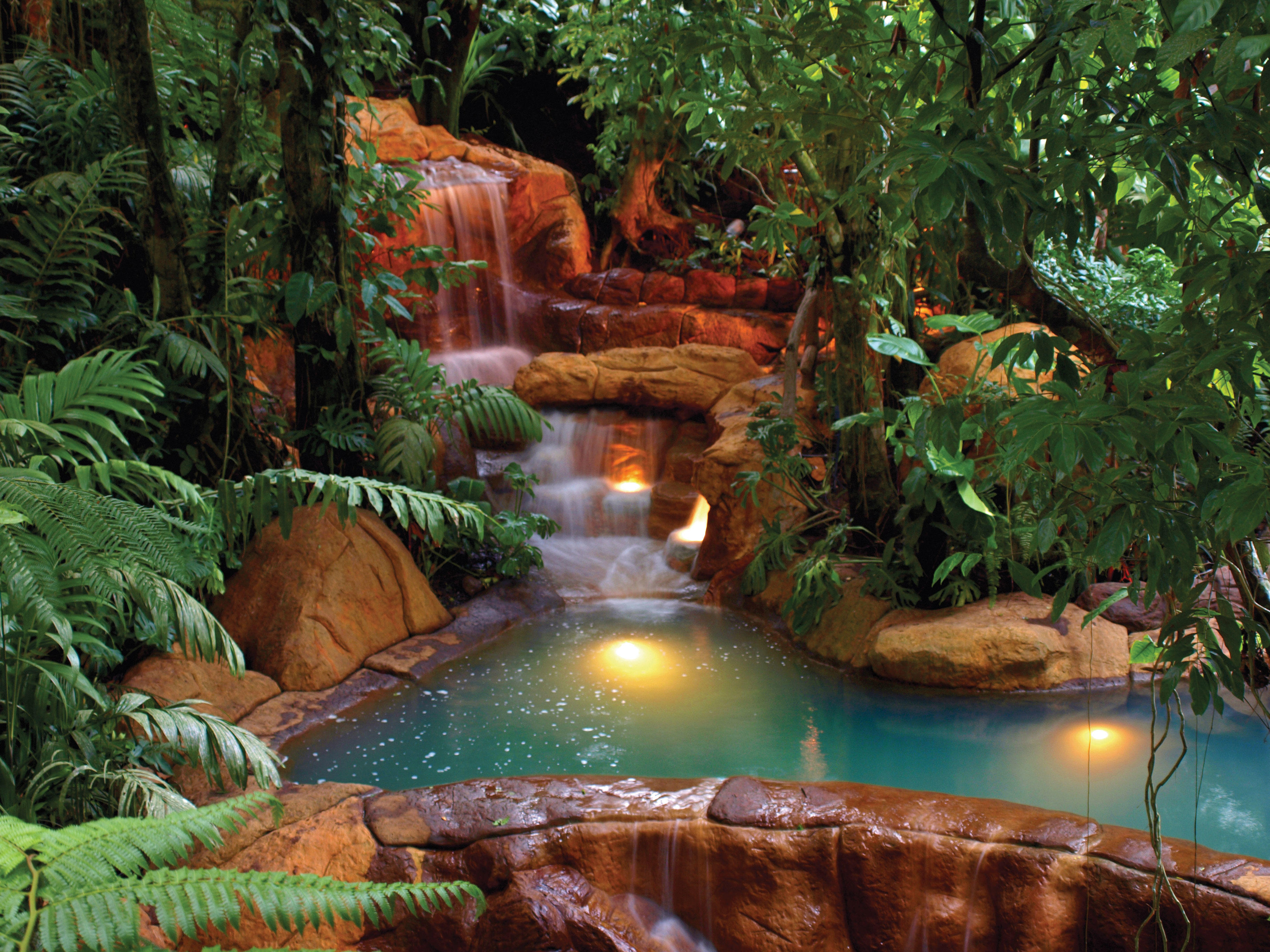 hot springs with a small waterfall