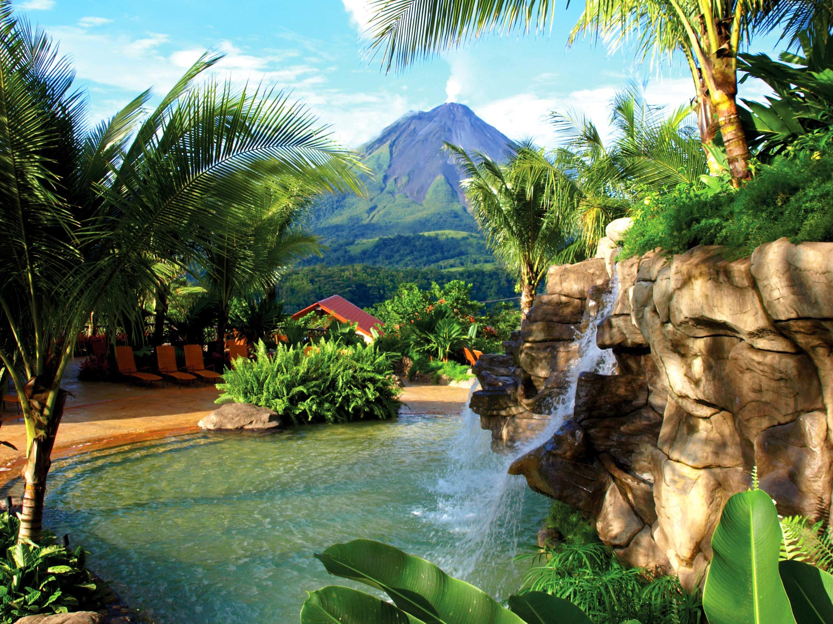 hot springs with volcano in the distant view