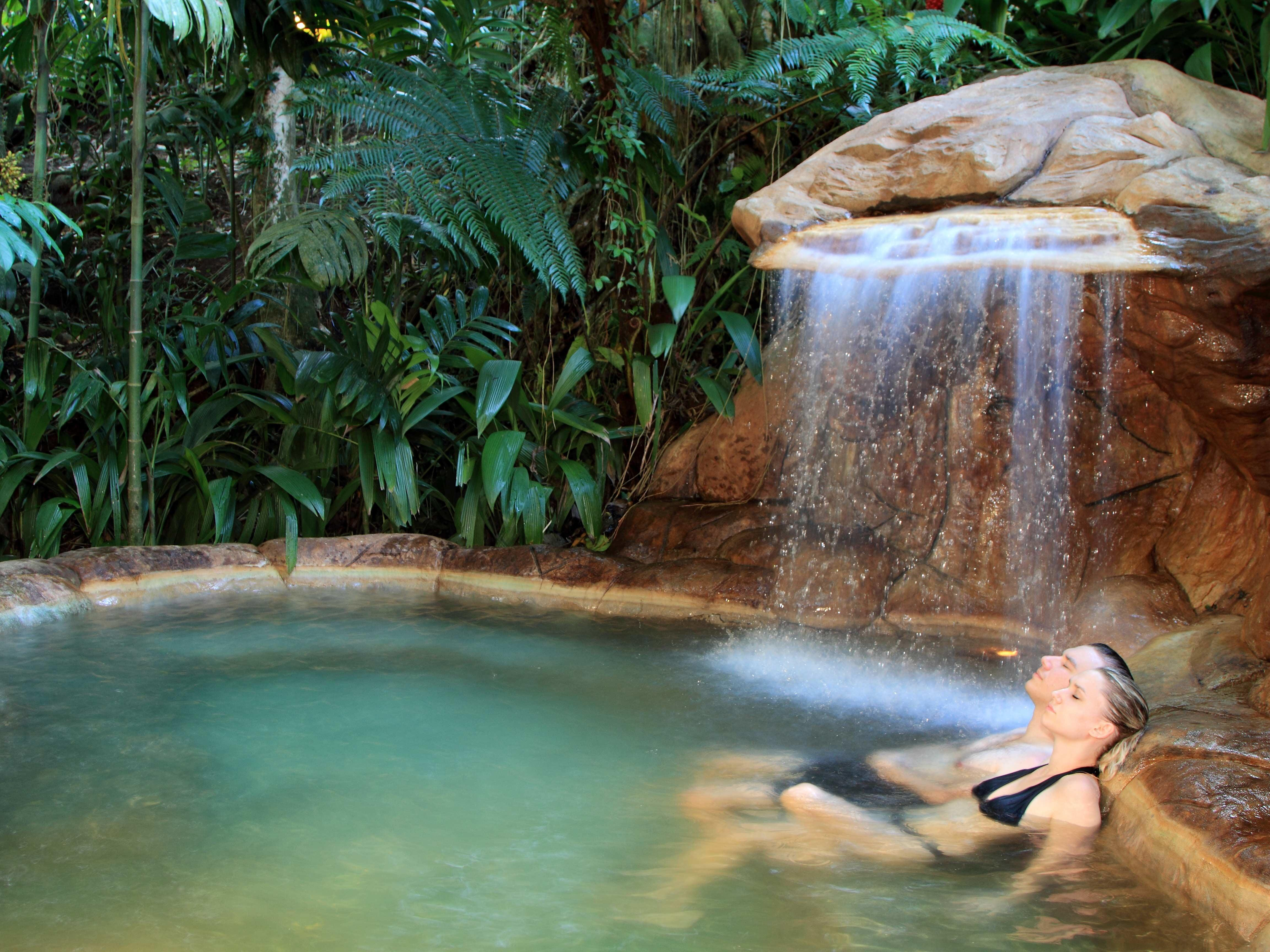 couple lounging in hot spring