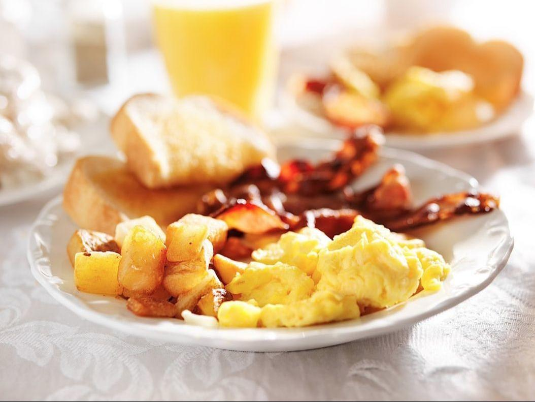 hot breakfast with eggs, bacon, toast and fruit