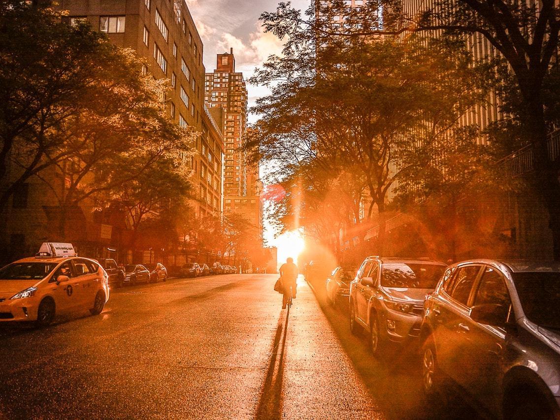 Silhouette walking towards a Manhattan sunset.