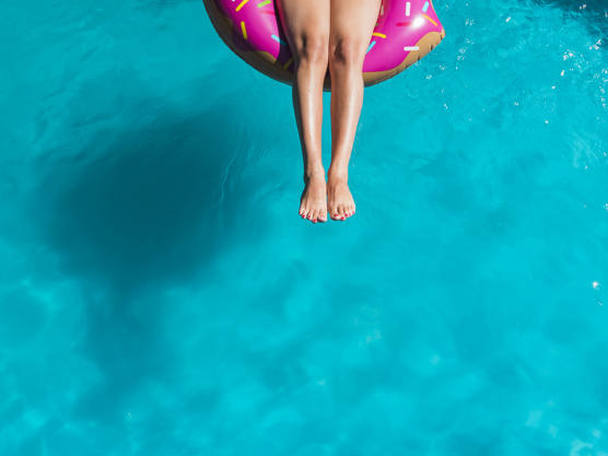 woman in pool floatie