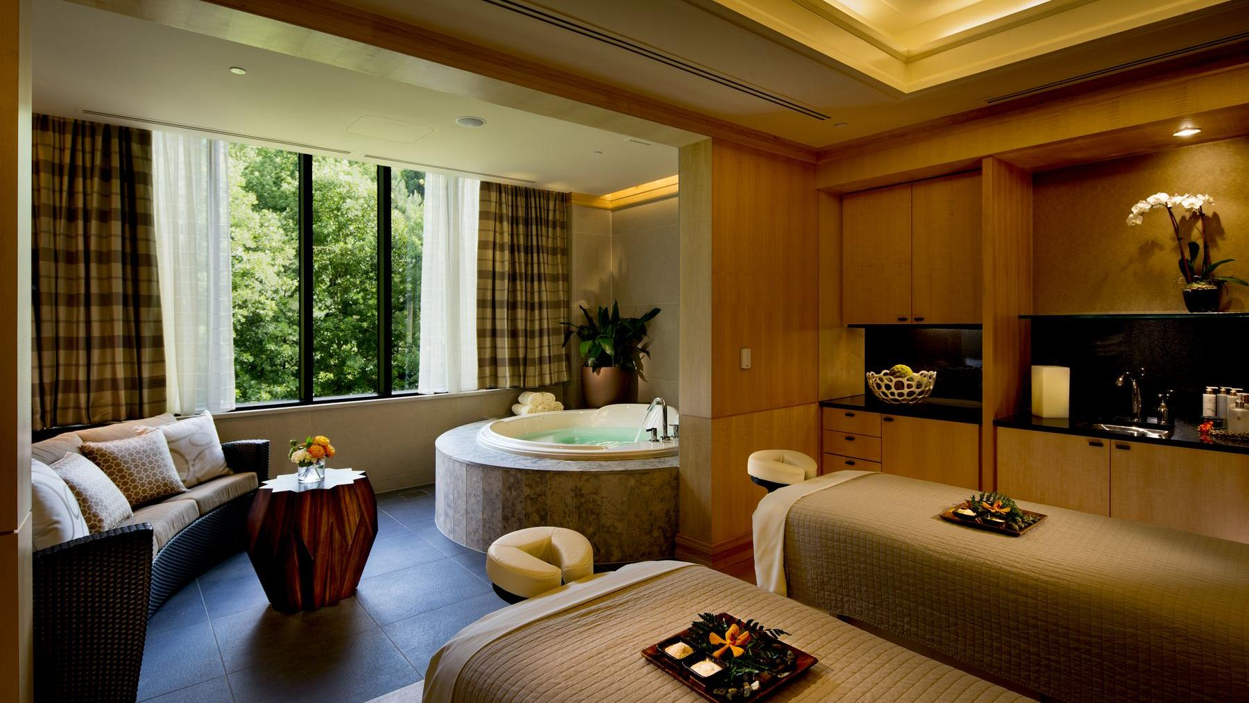 spa area with jacuzzi and massage chairs