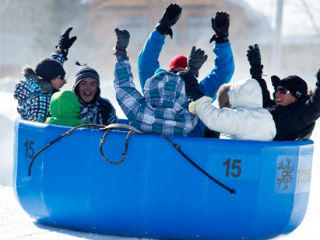 Group of people snow tubing