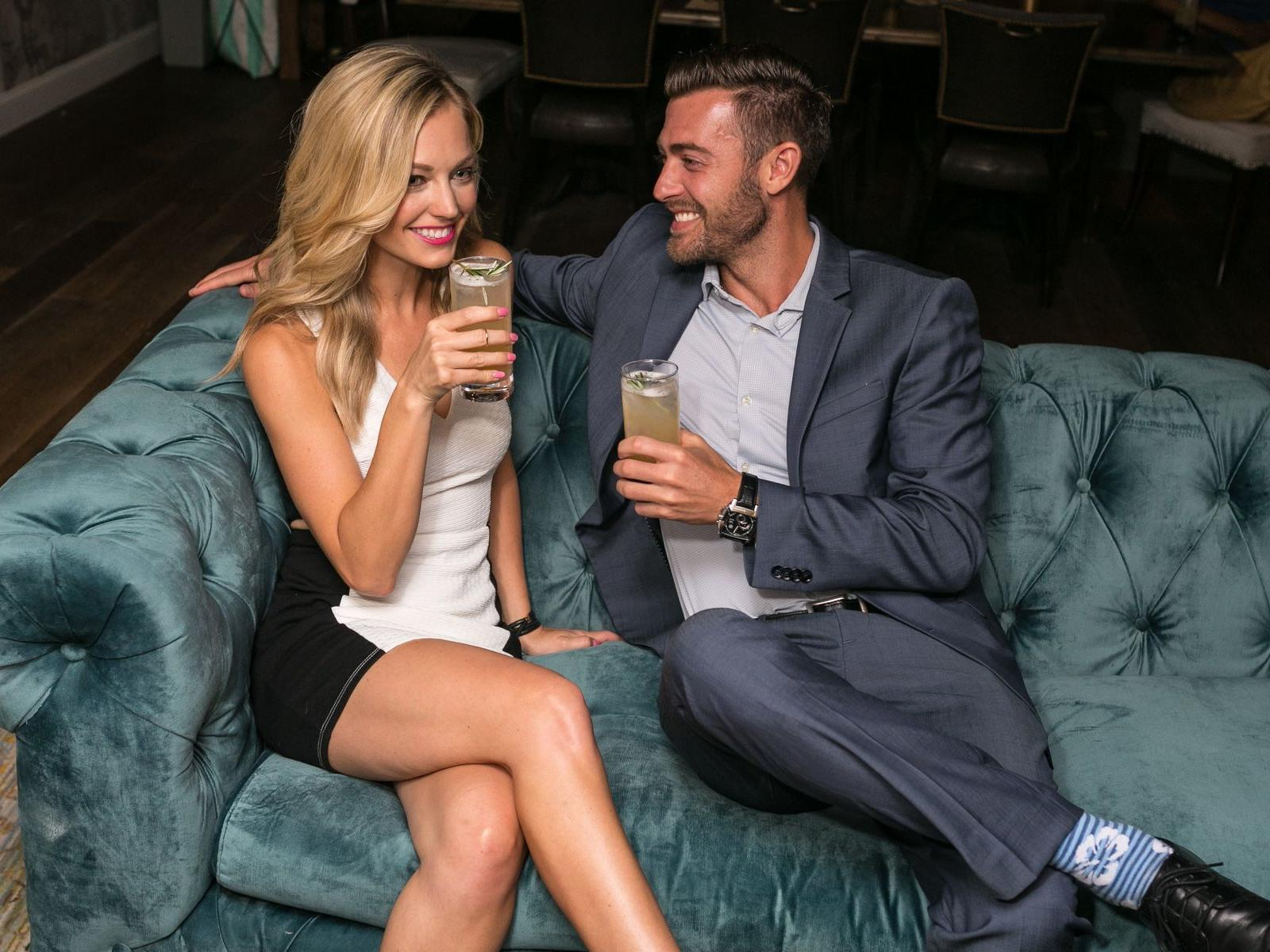 couple with cocktails on couch