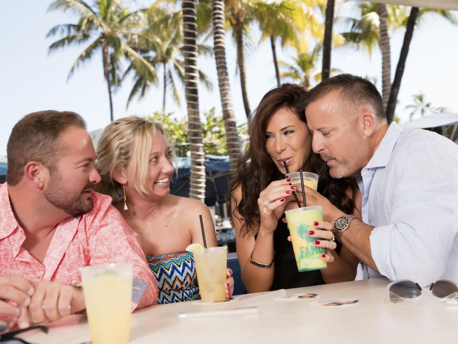 couples drinking frozen drinks