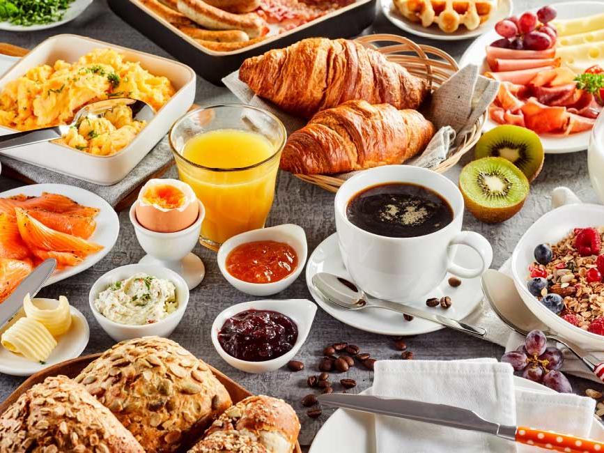 assortment of breakfast food items on table