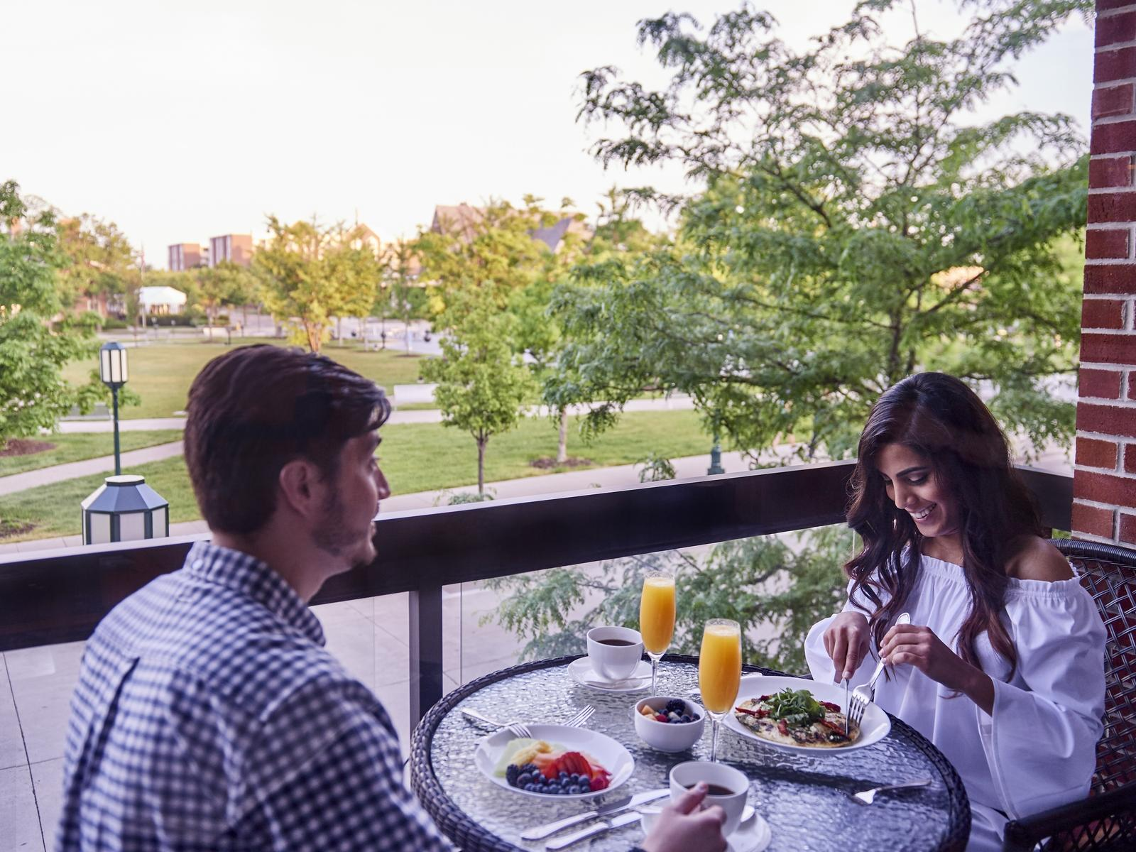 A couple enjoying brunch and mimosas
