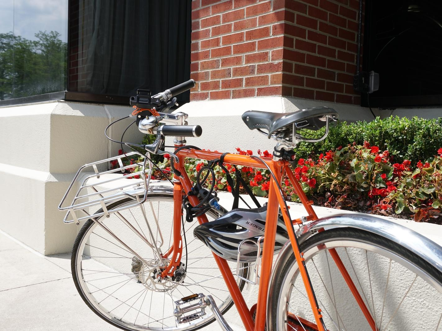 A red bicycle on a sidewalk