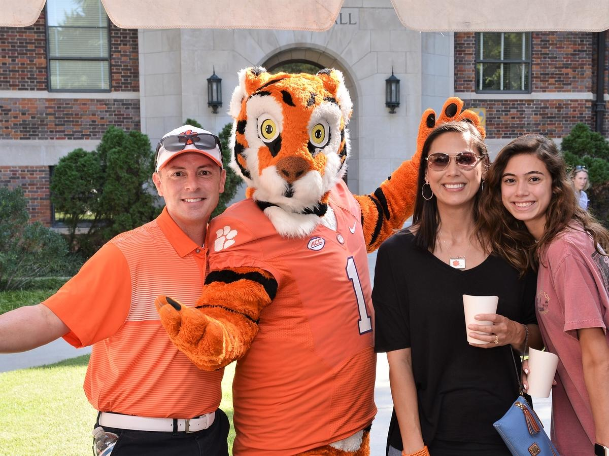 tiger mascot posing with clemson fans
