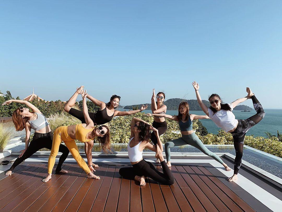 a group of participants doing yoga poses