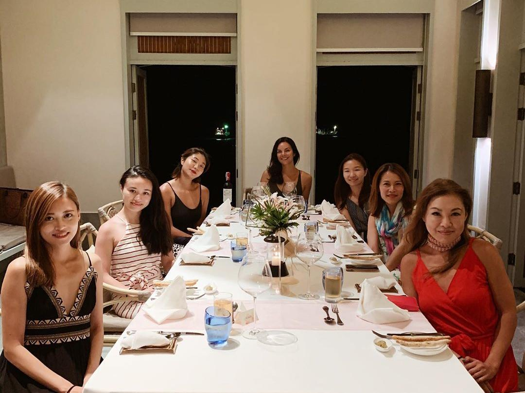 participants at enjoying dinner together