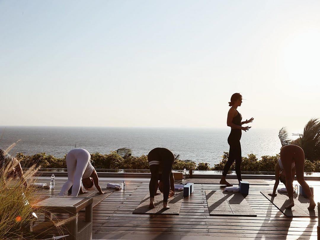 particpants doing yoga on the roof