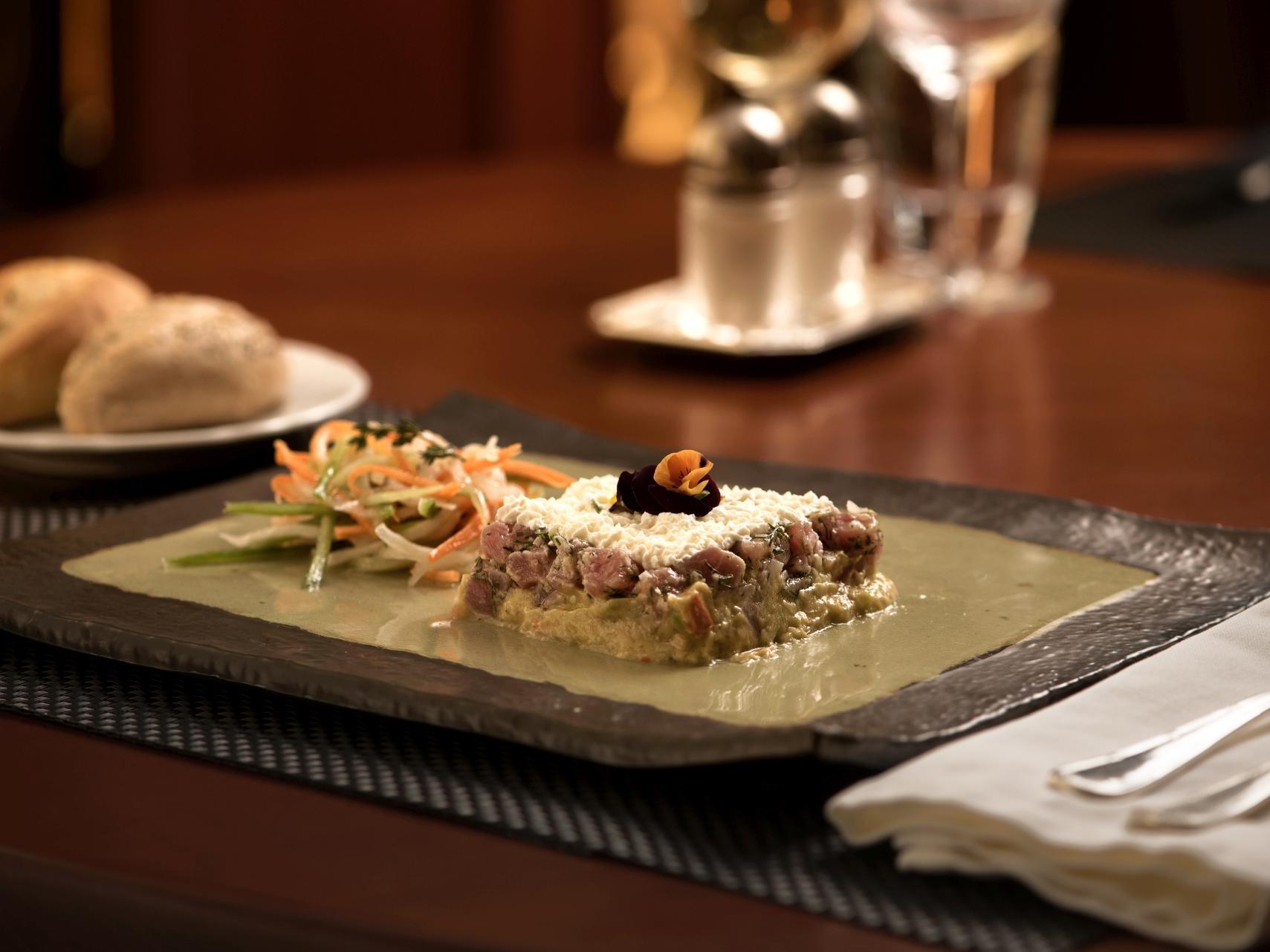 Tuna tartare with lime zest, guacamole and ouzo espuma