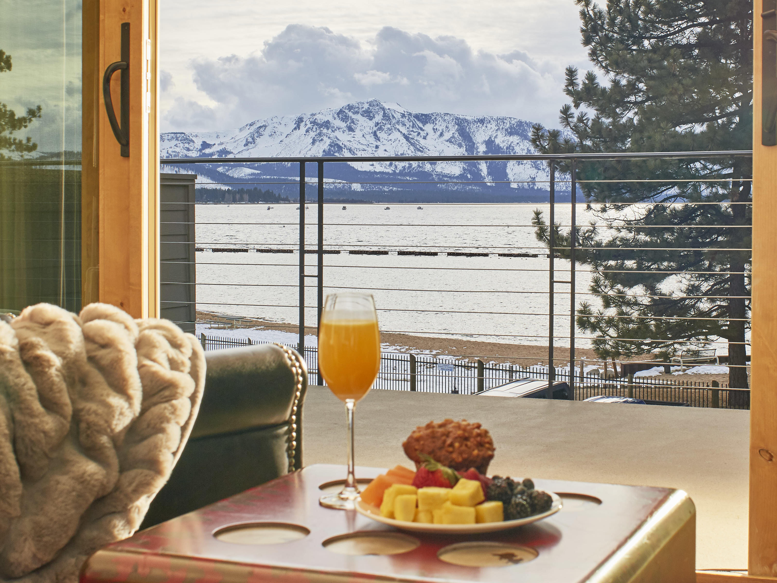 Breakfast with mimosa and lake view