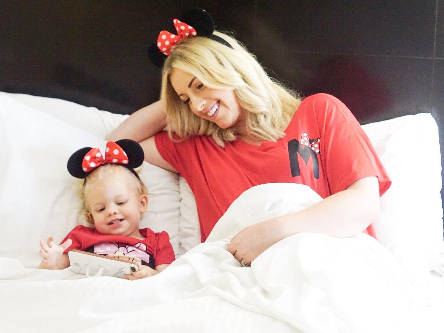 mom and daughter wearing minnie ears